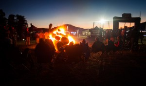 Racers and spectators stayed warm around the infamous bonfire at the JetBlack WSMTB 12 Hour race. Photo: Outer Image Collective