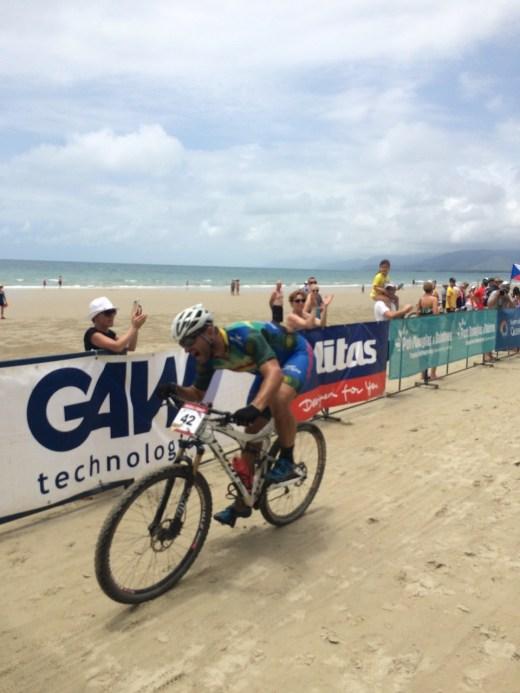 Martin powering across the finish line in Port Douglas.