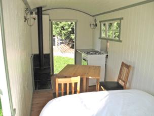 Inside a glamping shepherds hut, Devon.