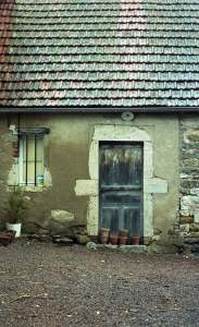 Typical French town house with damp walls