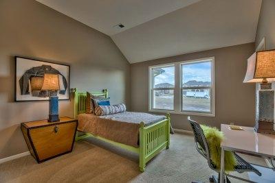 Larsen EX secondary bedroom with green bed