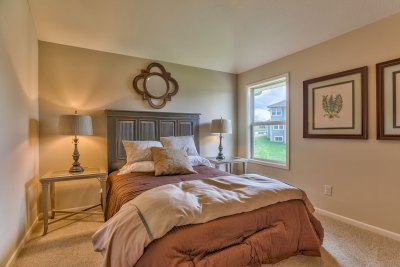 Somerset secondary bedroom with rust colored comforter