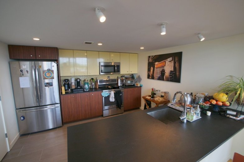 Roomy, gourmet kitchen with induction range and pantry.