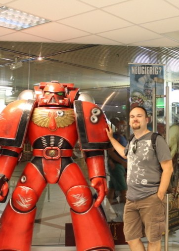 A Blood Angels grunt welcomes us.