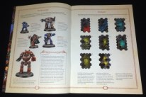 The pieces, game mechanics and how to play the game are explained in detail, with beautiful showcase models depicted on the pages.