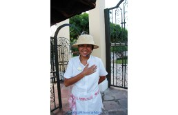 Smiling hostess in front of the entrance door of the Hotel Casa Velas. Puerto Vallarta, Jalisco, México