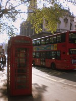 Classic. I was preparing for this to be a thing of the past, but alas red phone booths and double decker buses are quite plentiful. (Church of St Mary le Strand in the background.)