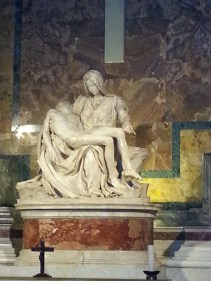 "Seeing Michelangelo's Pieta in person was one of the most moving experiences of my visit to St Peter's. I've seen this image 1000s of times. (My high school had a mural-- painted by my cousin, Joe Macklin, during his senior year.) Following along with mass in Italian (of which I have mastered ~10 words) one of the few phrases that jumped out to me was from the Kyrie: ""Signore, pietà. Cristo, pietà. Signore, pietà."" (in English: ""Lord, have mercy. Christ, have mercy. Lord, have mercy."")"