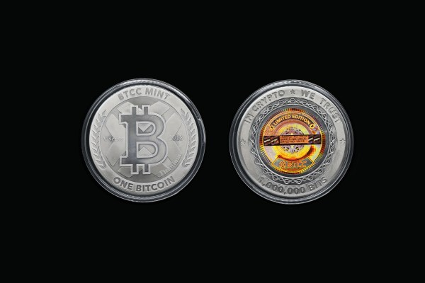 Side by side view of back and front of encapsulated 2018 1 Bitcoin Value, Physical Bitcoin from Bobby Lee and the BTCC Mint.