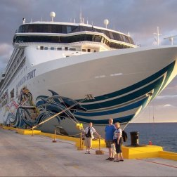 During one of the port stops on the Eastern Caribbean cruise, Roguetrippers pose in front of the Norwegian Spirit before boarding after a great day in Belize 2010.
