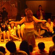 Belly dancer performing for the tourists on a desert safari in Dubai.