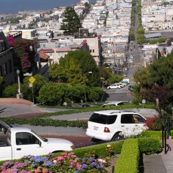 The winding road of Lombard street in San Francisco has many sharp turns.