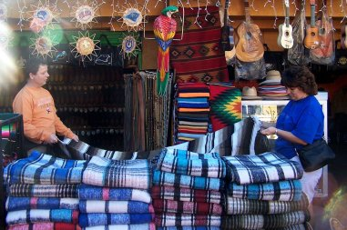 Roguetrippers shopping for hand crafted Mexican blankets and serapes.