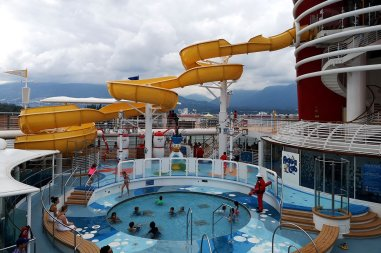 Cruise vacationers enjoying the pool and waterpark on the Disney Cruise ship Wonder.