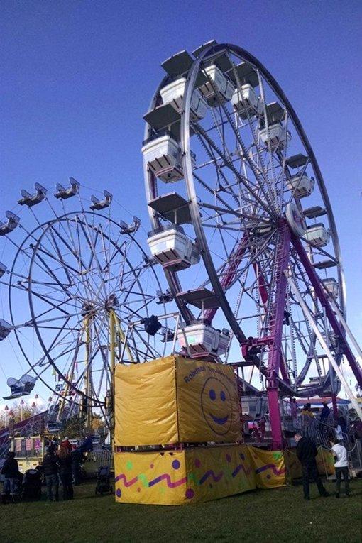 Duo of Ferris wheels at a Local Agricultural Fair - roguetrippers had fun.