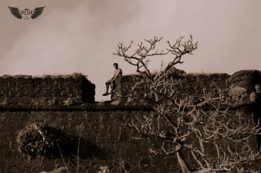 That's my friend Vamshi on the wall of Chapora fort, Goa