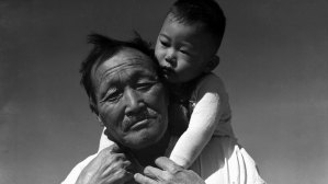 A Japanese American grandfather and grandson at Rohwer Camp
