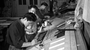 Japanese Americans working in the sign shop to earn money at Rohwer Camp