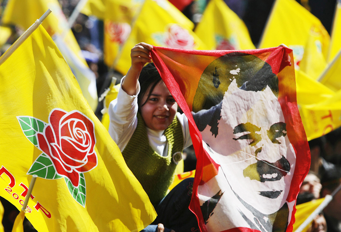 A demonstrator holds a portrait of jailed Kurdistan Workers Party (PKK) leader Abdullah Ocalan during a gathering to celebrate Newroz in the southeastern Turkish city of Diyarbakir in this March 21, 2009 file photo. To match feature TURKEY-OCALAN/ REUTERS/Umit Bektas/Files (TURKEY POLITICS RELIGION SOCIETY)