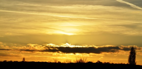 Sun, sky and clouds.