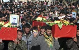 File photo shows men carrying coffins of Kurdish People's Protection Units members killed during clashes with al Qaeda-affiliated ISIL, at Khirbet Al-Banat village