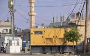 An electricity generator is seen in the town of Amuda