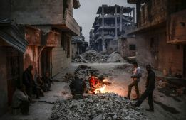 Since ISIS entered the war in force in 2013, the group has targeted civilians and destroyed whole neighborhoods as well. The above scene shows Kurdish Syrians in Kobane, Syria — a place besieged by ISIS for months. While ISIS was driven out of Kobane earlier this year, the cost to the city and its residents was absolutely devastating. (Yasin Akgul/AFP/Getty Images)