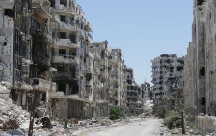 """These shattered buildings are in the Khaldiyeh neighborhood in Homs, in 2014. It's a city that was described as the """"capital of the revolution"""" when anti-government protests began in 2011 for the intensity of the protests there. The complete destruction there is a testament to how thoroughly Bashar al-Assad's strategy to deal with the protests — attack them mercilessly, and turn the peaceful revolution into a civil war — has succeeded. (Joseph Eid/AFP/Getty Images)"""