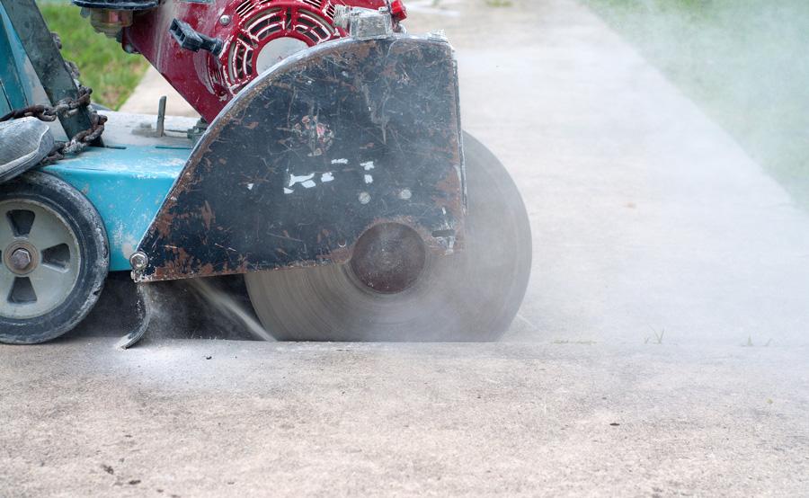 Worker Cutting concrete