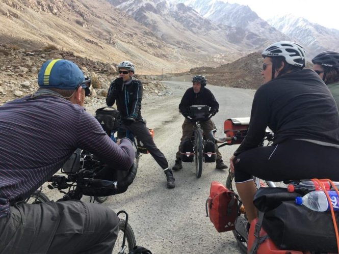 group-of-cyclists-talking-in-the-middle-of-the-road
