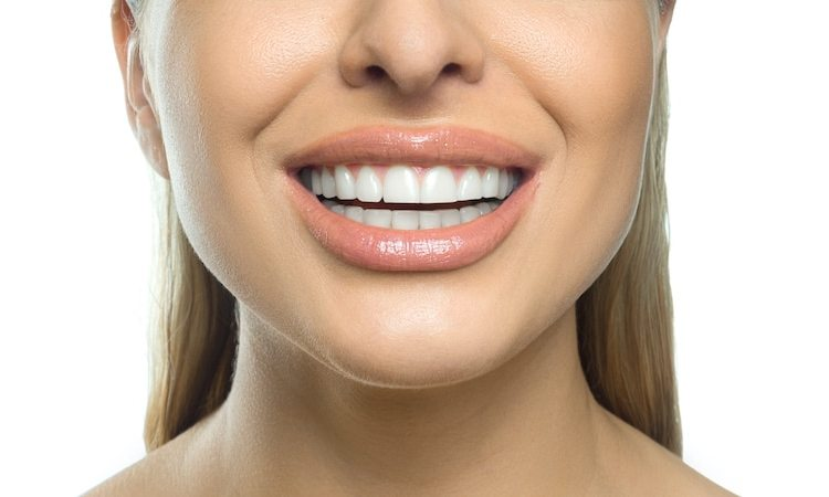 How can a cosmetic dentist improve my smile?