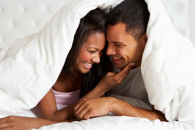 African American couple in bed shutterstock_141030937