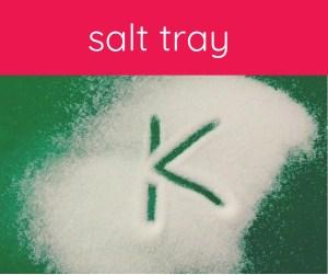 """green tray with """"K"""" written in salt"""