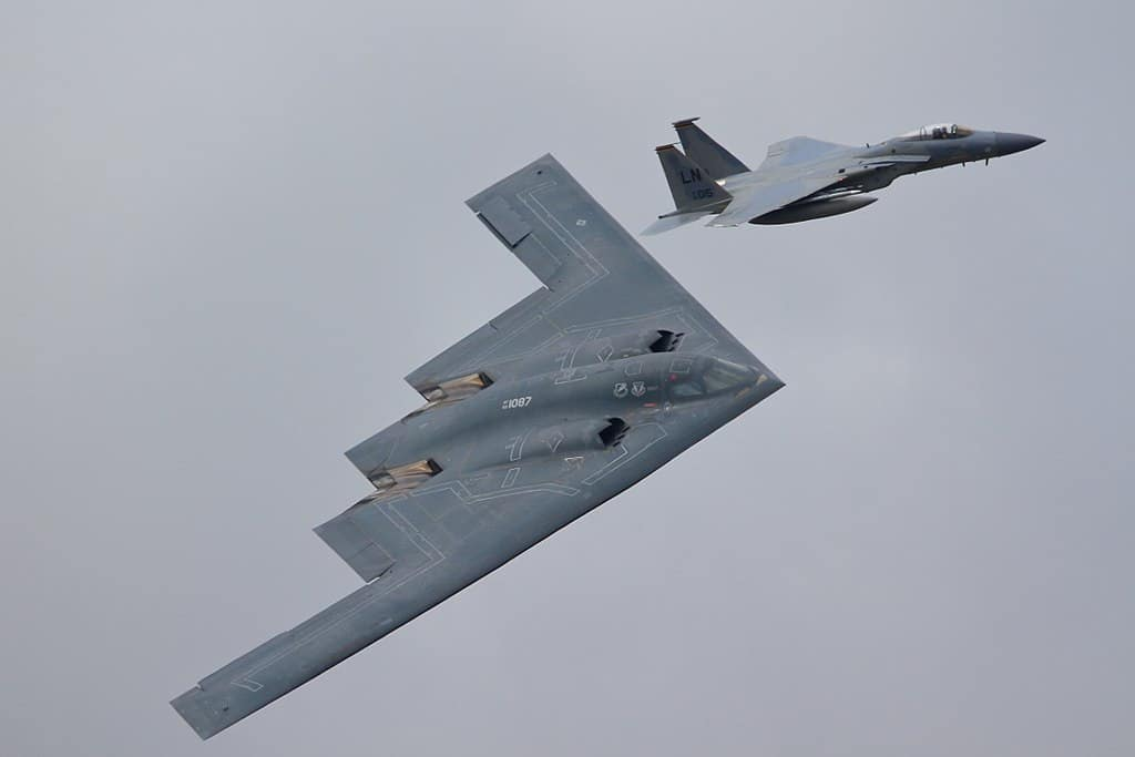 B2 Spirit side by side with an F15