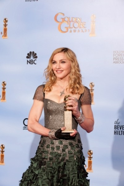 Madonna with her Golden Globe Award for Best Original Song - Motion Picture for 'Masterpiece' from her upcoming film 'W.E'