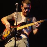 Rage Against the Machine bassist Tim Commerford has apologized for Limp Bizkit and other rap-metal bands that came in the group's wake