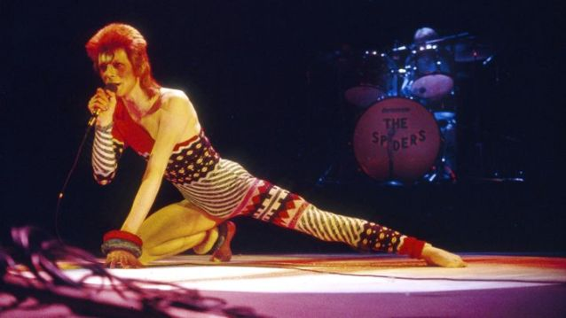 "David Bowie at the Hammersmith Odeon in London, 1973. ""Under the influence of America,"" Bowie dove deep into the dark side of his glam fantasies on 'Aladdin Sane,' released that same year. Ilpo Musto/REX/Shutterstock"