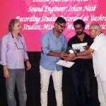 """Dhruv Ghanekar receiving the award for Music Producer of the Year – Non-Film for the album """"Dhruv Voyage"""" from Rajkumar Barjatya. Also in the photo (left to right): Anil Chopra – founder and chairman, IRAA Awards, Achille Forler and Ishan Naik."""