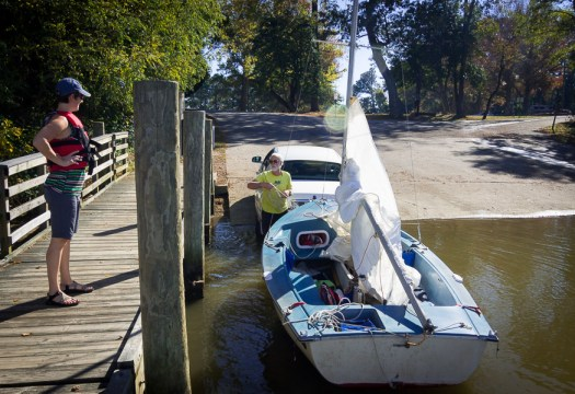 Launching the grass mini sailboat into the river