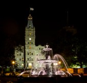 Evening shot of the Tourny Fountain and Parliament