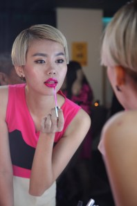Guests testing Revlon Ultra HD™ Lip Lacquer in HD Pink Ruby