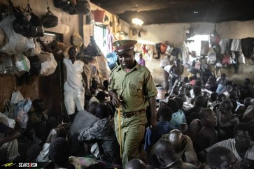 A-prison-officer-checks-the-prisoners-in-their-cell.
