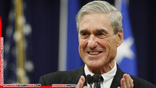 Mueller applauds key staff members during a farewell ceremony held for him at the Justice Department in Washington
