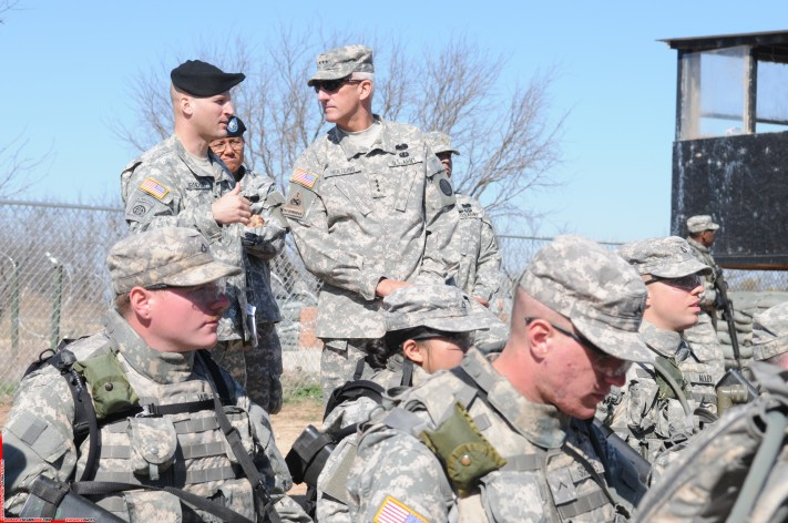 GOODFELLOW AIR FORCE BASE, Texas -- Lt. Gen. Mark Hertling speaks with Maj. James Arnold, 344th Military Intelligence Battalion, while visiting Forward Operating Base Sentinel, March 4, 2010. General Hertling, Deputy Commanding General for Initial Military Training, U.S. Army Training and Doctrine Command, visited Goodfellow to observe training. (U.S. Air Force photo/Airman 1st Class Clayton Lenhardt)