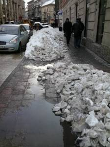 The sidewalk ice softens enough to chop through.