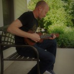 Roman on ukulele at Tom's