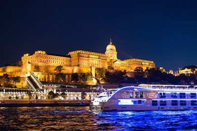 Buda castle and a boat on the Danube river