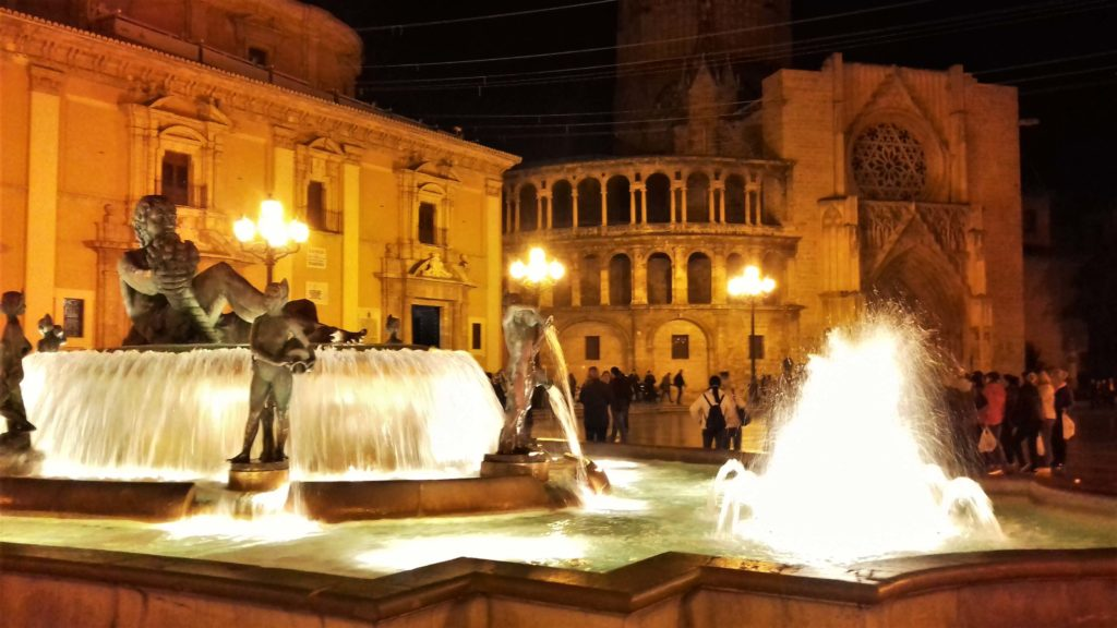 fountain at the placa virgen at night