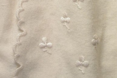 Embroidery Inspiration | Shamrocks and Clovers. Baby wrapper embroidered with tiny shamrocks.