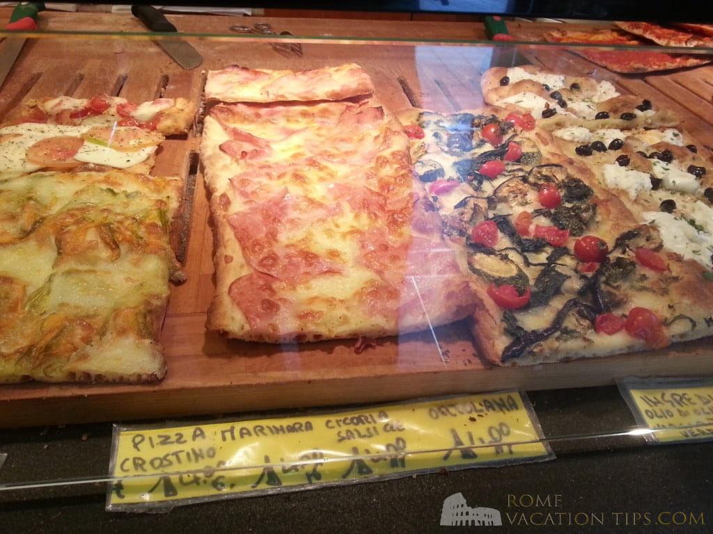 Pizza in Rome. Left-to-right: zucchini flower; ham; zucchini and tomato; and buffalo mozzarella pizza slices